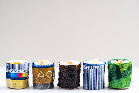 Sushi Wrapped in Plastic. Ocean Pollution And Environmental Conservation Concept.
