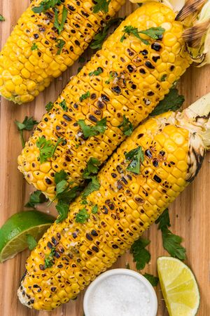BBQ Grilled COrn on Cob with Lime and Coriander. Mexican Street Food.