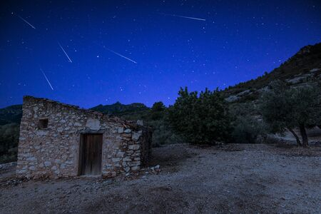 Perseid Meteor Shower over Rural House in Spain.