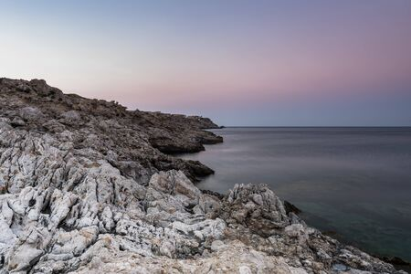 Rocky Dramatic Seaside and Mediterranean Sea, Long Exposure Sunrise, Greece.