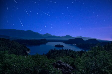 Perseid MEteor Shower over Bled Lake at Starry Dark Night in Summer.