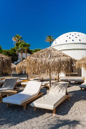 Luxury Chairs and Umbrellas on Kalithea Beach,Rhodes,Greece.