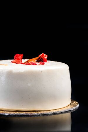 Artisan Monoportion Patisserie Dessert Cake on Black Reflective Background.