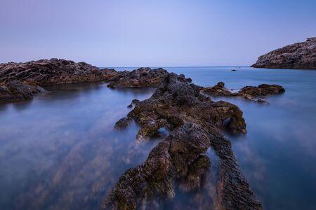 Dramatic Rocks in Mediterranean Sea, Long Exposure Sunset,Greece. 写真素材