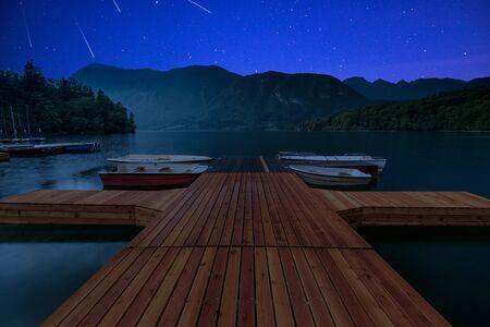 Perseid MEteor Shower at wooden pier at Bohinj Lake, Slovenia.