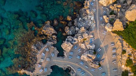 Secret Beach on Rocky Shore and Blue Waters, Greek Island, Drone View.