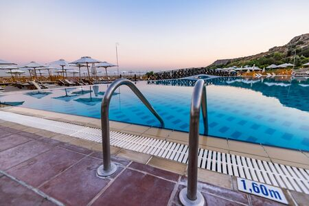 Entrance to Swiming Pool at Hotel Resort, Sunrise Blue Hour, Rhode, Greece.