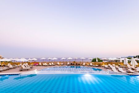 Luxury Swimming Pool at Sunrise in Hotel Resort, Rhodes, Greece. Фото со стока