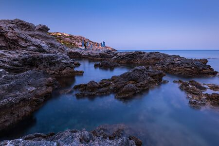 Twilight Over Rocky Beach and Cliffs at Rhodes Island,Greece. Stock Photo