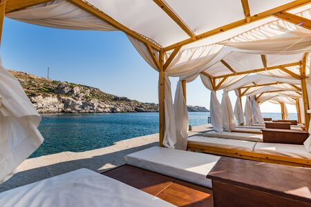 Luxury and Relaxing place at Kalithea Spring Beach, Rhodes,Greece. 免版税图像