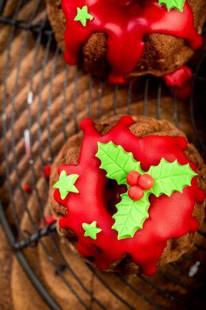 Christmas Cake with Festive Sugar Decorations on Christmas Table.