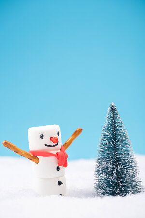 Happy Funny Snowman Play in Snow by Christmas Tree.