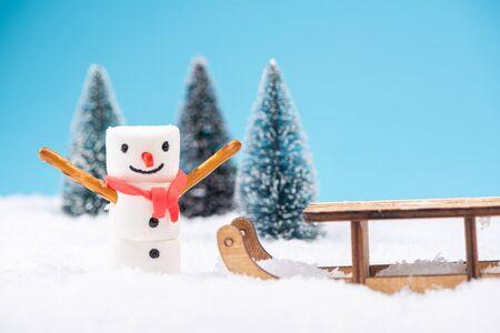 Marshmallow Funny Snowman Play in Snow. Festive Christmas Creative Concept Card. Фото со стока