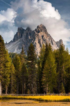 Italian Dolomites Dramatic Peaks at Lake Antorno at Fall Season.