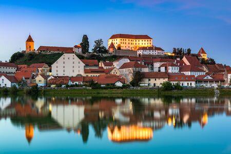Illuminated City of Ptuj in Slovenia at Twilight.