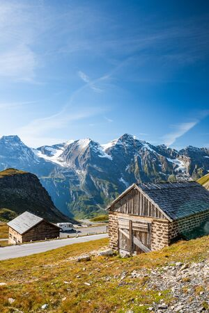 Wooden Hut at High Alpine Road with Mountains in Background, Austria.