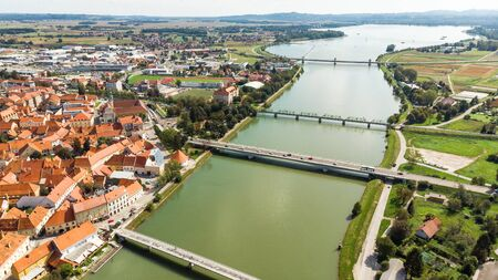 River Drava Aerial Drone View with Old Town of Pruj in Slovenia. Stockfoto