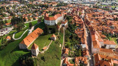 Ptuj Grad in Slovenia, Historic Old Town and Castle. Aerial Drone View. Archivio Fotografico - 131108699