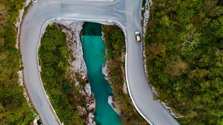 Napoleon Bridge Over Soca River in Slovenia. Aerial Drone Top Down View. Autumn Foliage Colors. Archivio Fotografico - 131793883