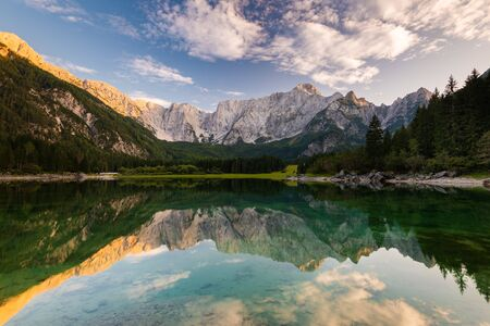 Panoramic View over Fusine Lake in Italy with Julian Alps in Background. Archivio Fotografico - 131793872