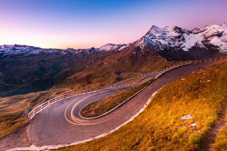 Light Motion Trials on Curvy Serpentine Road in High Mountains. Archivio Fotografico - 131793950