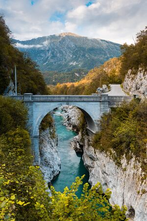 Famous Napoleon Bridge at River Soca with Turquoise Water, Slovenia. Stock Photo