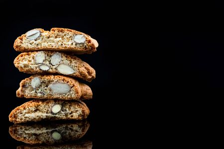 Italian Traditional Almond Biscuits Cantucci. Studio Shot on Black Background.