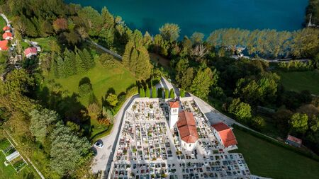 Church and Cemetery at Most na Soci in Slovenia. Aerial Drone View. Imagens - 132789665