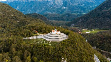 Kobarid Caporetto First War Memorial on Hill. Aerial Drone View. Stock Photo