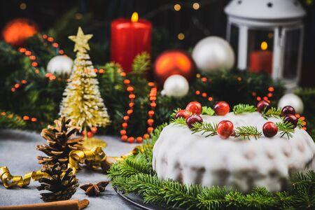 Christmas Fruit Cake on Festive Dinner Table.