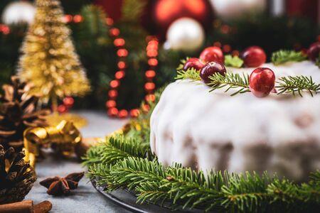 Traditional Fruit Cake on Christmas Table.
