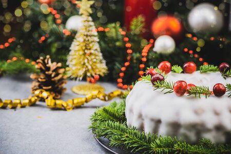 Traditional Pudding Cake on Festive Christmas Table.