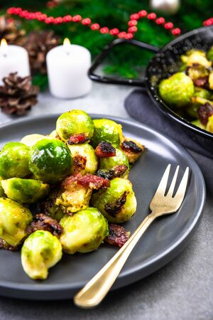 Roasted Brussels Sprouts with Bacon. Christmas Traditional Dish.