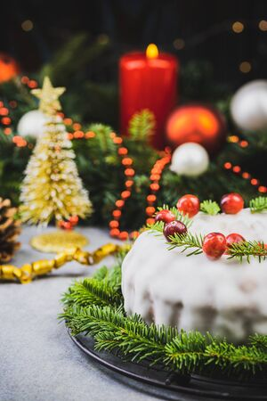 Christmas Traditional Cake on Festive Decorated Table.