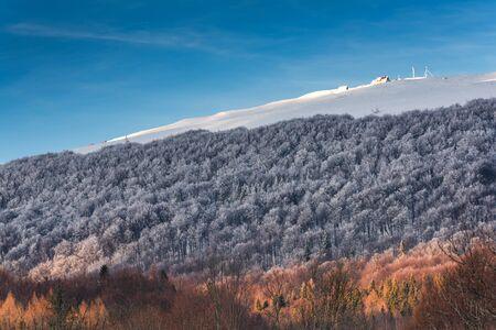 Refuge, Wooden Shelter Hut  Chatka Puchatka  in Bieszczady Carpathian Mountains at Winter Season.