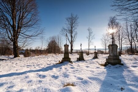 Small Cemetary in Bieszczady Village Bystre at Winter Time Covered in Snow. Reklamní fotografie