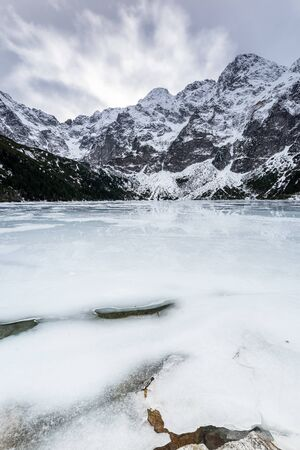 Morskie Oko Lake Covered in Ice at Winter in Tatra Mountains Poland. Фото со стока