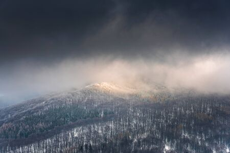 Dramatic and Moody Image of Weather in Mountains at Winter Time. Reklamní fotografie