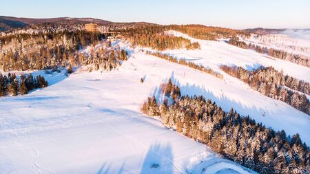 Tree Top Observation Tower in Slotwiny near Krynica in Poland at Winter Season. Aerial Drone view.