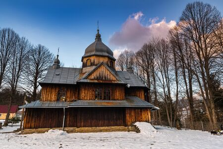 Exterior of St. Nicholas Orthodox Church in Chmiel. Bieszczady Architecture in Winter. Carpathia Region in Poland.