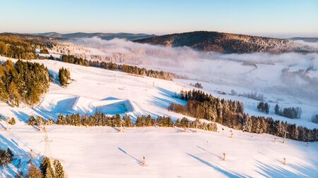 Slotwina Ski Lift near Krynica in Poland at Sunrise in Winter Season. Aerial Drone View. Reklamní fotografie