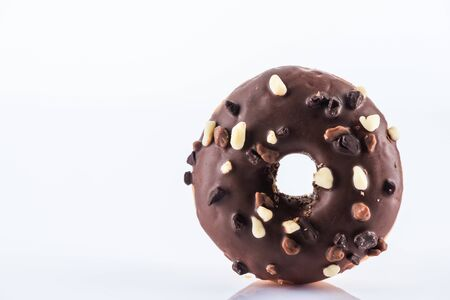 Single Chocolate Donut or Doughnut. Studio Photo on White Background, Cle Up view.