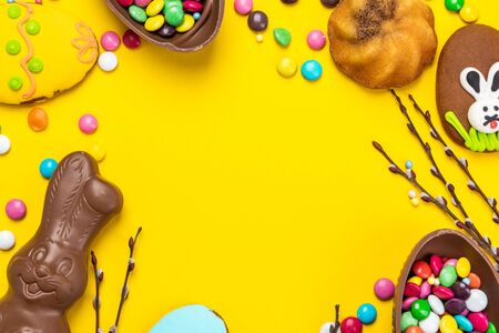 Easter Theme Background. Chocolate Rabbit, Egg and Festive Food.
