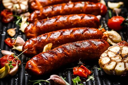 Barbecue Pork Sausages with Grilled Vegetables,Garlic, Herbs and Spices.