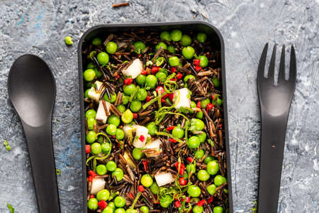 Coloful Healthy Pea and Wild Rice Salad in Bento Box.