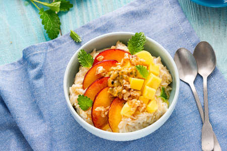 Sweet and Healthy Porridge with Fresh Fruits. Diet Breafast Idea.