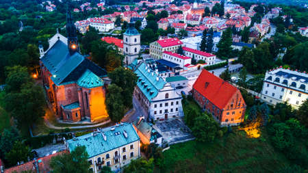 Sandomierz, Poland. Aerial Drone View of Medieval Old Town Hall Tower, Gothic Cathedral, MEdieval Castle and Vistula River.