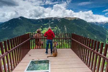 Man with Dog at Observation Deck in Andorra High Mountains. Active Couple.