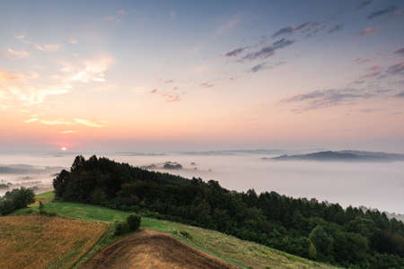 Sunrise Over Rolling Hills in Countryside in Poland.