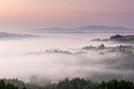 Panoramic View over Rolling Hills in Morning Fog at Sunrise. Lesser Poland.